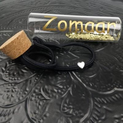 Armband in glazen koker -€8,95