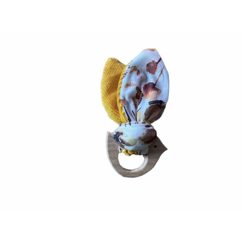 Bijtring vogeltje met knisperende vleugeltjes - wildflower/geel -€8,50